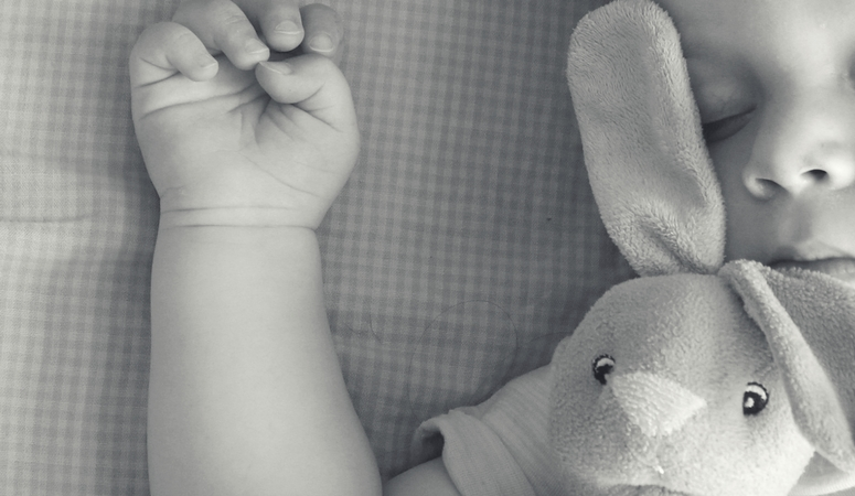 Why a baby monitor is an essential new mom tool. Baby sleeping well, no mom anxiety.