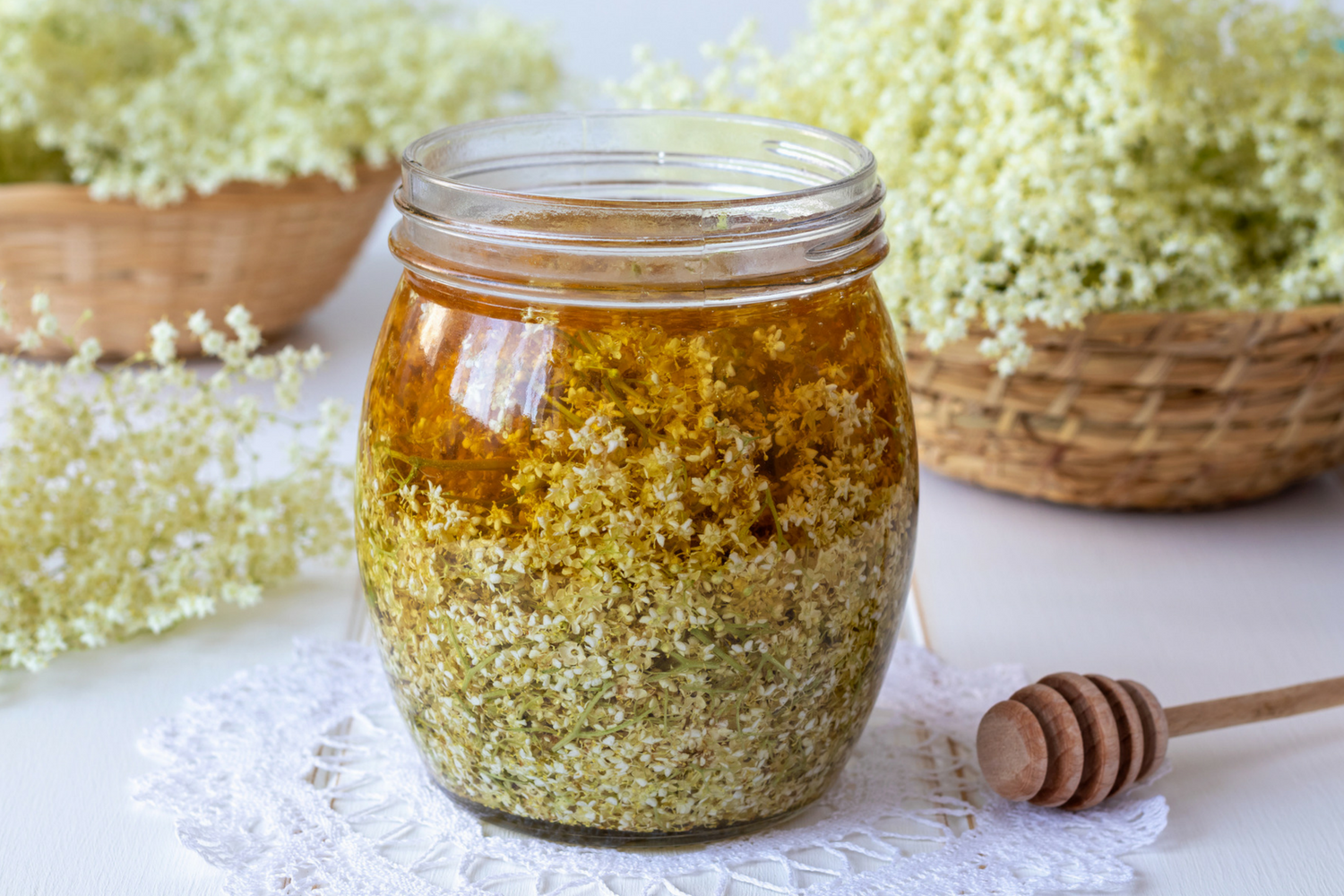 Elder flower syrup in glass jar.